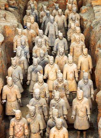 imperialism: XIAN, SHAANXI PROVINCE, CHINA - OCTOBER 28, 2015: Ranks of terracotta infantrymen of the famous Terracotta Army inside the Qin Shi Huang Mausoleum of the First Emperor of China. Editorial