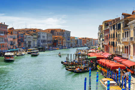 rialto: Beautiful view of the Grand Canal with gondolas and water buses from the Rialto Bridge (Ponte di Rialto) in Venice, Italy. Venice is a popular tourist destination of Europe.