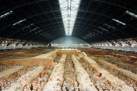 emperor of china: XIAN, SHAANXI PROVINCE, CHINA - OCTOBER 28, 2015: Main view of the Terracotta Army (Terracotta Warriors and Horses) inside the Qin Shi Huang Mausoleum of the First Emperor of China.