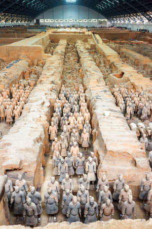 emperor of china: XIAN, SHAANXI PROVINCE, CHINA - OCTOBER 28, 2015: Ranks of terracotta soldiers of the famous Terracotta Army inside the Qin Shi Huang Mausoleum of the First Emperor of China. Editorial
