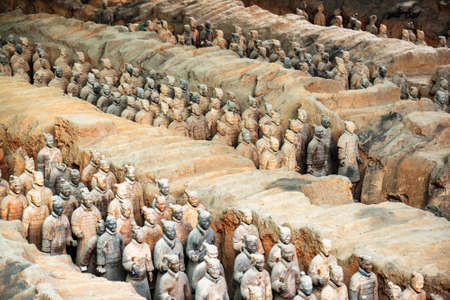 emperor of china: XIAN, SHAANXI PROVINCE, CHINA - OCTOBER 28, 2015: View of infantry of the famous Terracotta Army inside the Qin Shi Huang Mausoleum of the First Emperor of China.