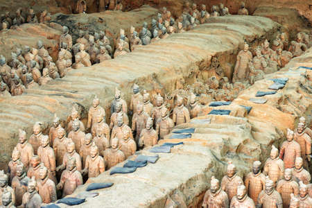 imperialism: XIAN, SHAANXI PROVINCE, CHINA - OCTOBER 28, 2015: View of the Terracotta Warriors and remains of sculptures in corridors of the Qin Shi Huang Mausoleum of the First Emperor of China.