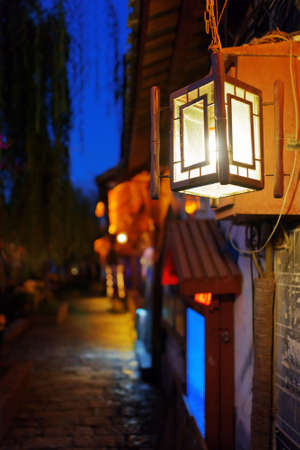 chinatown: Night view of traditional Chinese street lamp in the Old Town of Lijiang, Yunnan province, China. The Old Town of Lijiang is a popular tourist destination of Asia. Focus on the lamp.