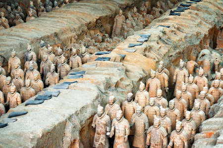 emperor of china: XIAN, SHAANXI PROVINCE, CHINA - OCTOBER 28, 2015: View of the Terracotta Warriors and remains of sculptures in corridors inside the Qin Shi Huang Mausoleum of the First Emperor of China. Editorial