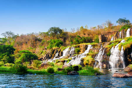 water fall: Beautiful view of natural cascading waterfall with crystal clear water and pool in autumn. Sunny fall landscape in Vietnam. The Pongour waterfall (PonGour) is a popular tourist destination of Asia.