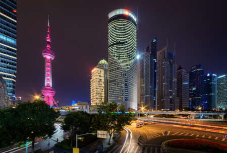 oriental pearl tower: Night view of the Oriental Pearl Tower and other modern buildings on Century Avenue in downtown, the Pudong New District (Lujiazui) of Shanghai, China. The famous tower glows pink. Editorial