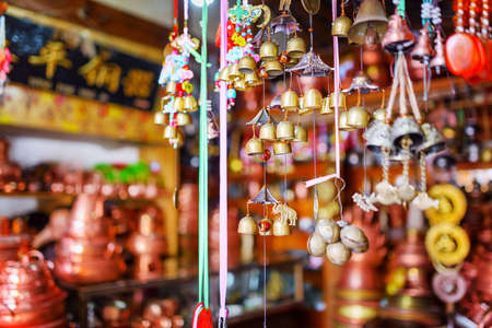 souvenir traditional: LIJIANG, YUNNAN PROVINCE, CHINA - OCTOBER 23, 2015: Wide range of traditional oriental Chinese wind chimes at souvenir shop in the Old Town of Lijiang. Shallow depth of field. Editorial