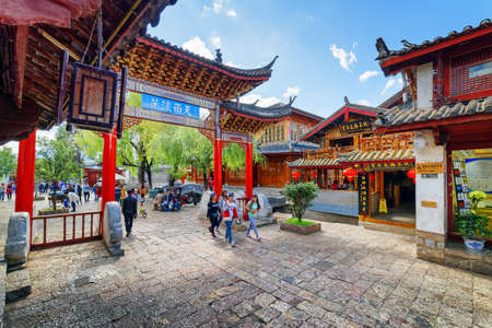 traditional house: LIJIANG, YUNNAN PROVINCE, CHINA - OCTOBER 23, 2015: Scenic view of traditional oriental Chinese red carved wooden gate in the Old Town of Lijiang. Lijiang is a popular tourist destination of Asia.