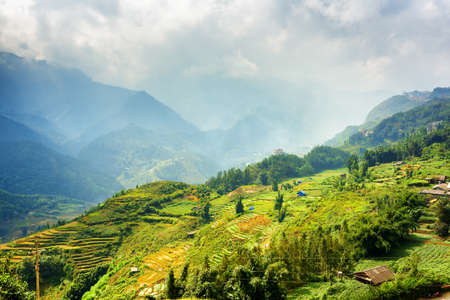 lien: Beautiful view of rice terraces at highlands of Sapa District, Lao Cai Province, Vietnam. Sa Pa is a popular tourist destination of Asia. The Hoang Lien Mountains are visible in background.