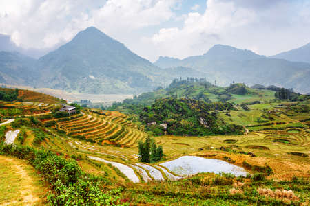 Scenic view of rice terraces filled with water at highlands of Sapa District, Lao Cai Province, Vietnam. Sa Pa is a popular tourist destination of Asia. Stock Photo