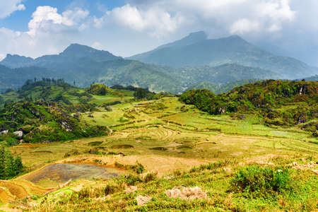 lien: Scenic view of highlands in Sapa District, Lao Cai Province, Vietnam. Sa Pa is a popular tourist destination of Asia. The Hoang Lien Mountains are visible in background.