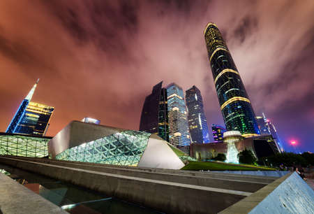 tower house: Amazing night view of the Guangzhou Opera House, skyscrapers and other modern buildings at the Zhujiang New Town, China. The Guangzhou International Finance Centre (West Tower) is visible at right.