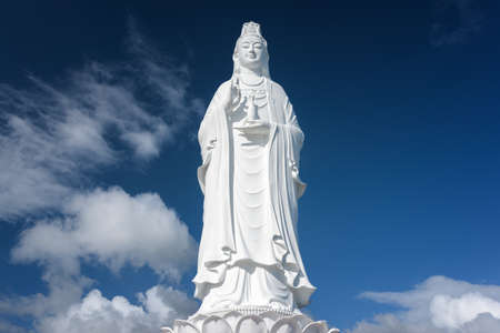 bodhisattva: Majestic white Buddha statue on blue sky background. The Lady Buddha (the Bodhisattva of Mercy) at the Linh Ung Pagoda in Danang (Da Nang), Vietnam.