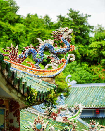 buddhist temple roof: Traditional colorful mosaic dragon on roof of the Linh Ung Pagoda in the Marble Mountains (Ngu Hanh Son), Danang (Da Nang), Vietnam. The Marble Mountains is a popular tourist destination of Asia.