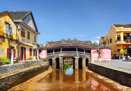Beautiful view of the Japanese Covered Bridge (Cau Chua Pagoda, Cau Nhat Ban, Lai Vien Kieu) in Hoi An Ancient Town (Hoian), Vietnam. Scenic old bridge is a popular tourist attraction of Asia.