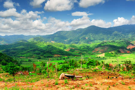 tay: Beautiful view of scenic mountains and green rice fields at the Tay Nguyen (the Central Highlands) in Dak Lak Province (Daklak), Vietnam. Dak Lak Province is a popular tourist destination of Asia.