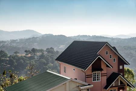 dalat: Scenic house among pine woods and mountains at Dalat (Da Lat) in Vietnam. Amazing landscape in morning sunshine. Stock Photo