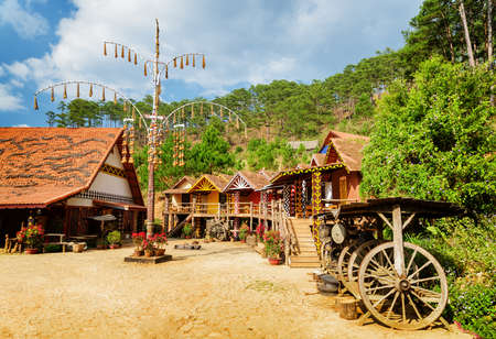 cu: Scenic view of the Cu Lan Village at Vietnam. Amazing colorful authentic houses of the cozy village among green woods. The Cu Lan Village is a popular tourist destination of Asia.