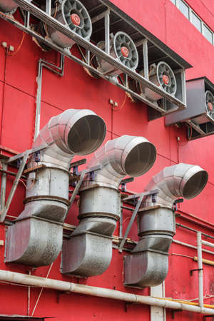 venting: Ventilation pipes outside a red building. View of venting system. Urban industrial concept.