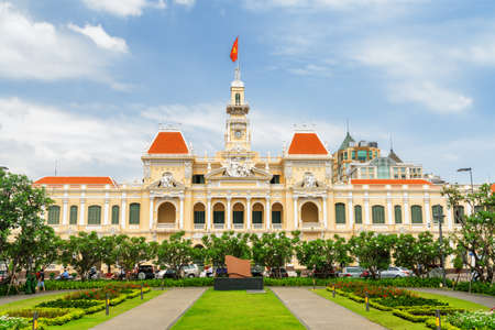 Facade of the Ho Chi Minh City Hall on blue sky background. Ho Chi Minh City is a popular tourist destination in Vietnam. Stockfoto