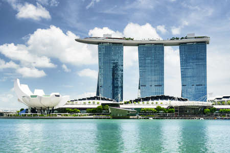 Amazing view of Marina Bay with azure water and the Waterfront Promenade in the Central Area of Singapore. Scenic view of skyscrapers and other modern buildings. Beautiful cityscape. Singapore skyline