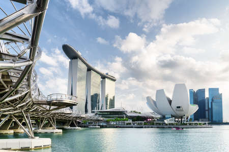 Singapore - February 19, 2017: Amazing view of the Helix Bridge, the Marina Bay Sands Hotel and the ArtScience Museum. Modern office high-rise buildings of downtown are visible in background at right. Editorial