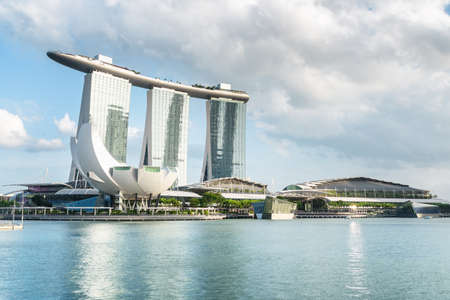 Singapore - February 19, 2017: Wonderful view of the famous Marina Bay Sands Hotel and the ArtScience Museum by the bay. Fantastic modern towers and the SkyPark bridge on the top of skyscrapers. Editorial