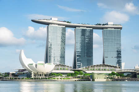 Singapore - February 19, 2017: Scenic view of the famous Marina Bay Sands Hotel and the ArtScience Museum by the bay. Amazing modern towers and the SkyPark bridge on the top of skyscrapers.
