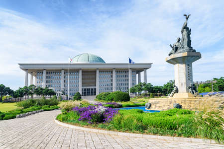The National Assembly Proceeding Hall at Seoul in the Republic of Korea on blue sky background. The building serves as the location of the legislative branch of the South Korean national government.