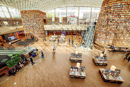 Seoul, South Korea - October 14, 2017: Amazing view of the Starfield Library reading area from the second floor. The public library is a popular destination among tourists and citizens of Seoul.