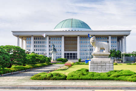 Main view of the National Assembly Proceeding Hall at Seoul in the Republic of Korea on sunny day. The building serves as the location of the legislative branch of the South Korean national government