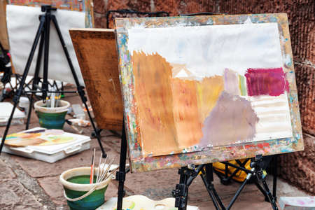 Fenghuang, China - September 22, 2017: Unfinished painting on easel at old street of Phoenix Ancient Town (Fenghuang County). The First Fenghuang Arts Year Exhibition. Sketch of picture on paper.