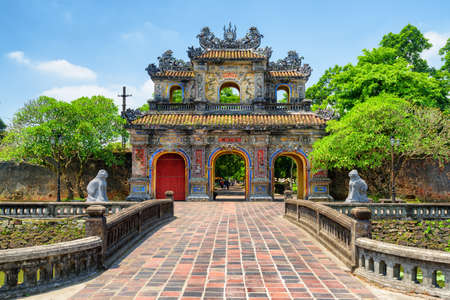 Scenic view of the East Gate (Hien Nhon Gate) to the Citadel with the Imperial City on summer sunny day in Hue, Vietnam. The colorful gate is a popular tourist attraction of Hue.