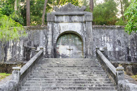 Stairs and locked bronze door to the burial site of Emperor Minh Mang in the royal tomb at Hue, Vietnam. Hue is a popular tourist destination of Asia.