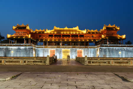 Beautiful evening view of the Meridian Gate to the Imperial City with the Purple Forbidden City within the Citadel in Hue, Vietnam. Hue is a popular tourist destination of Asia.