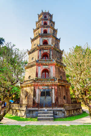 Phuoc Duyen Tower at the Pagoda of the Celestial Lady (Thien Mu Pagoda) in Hue, Vietnam. Phuoc Duyen Tower is a symbol of the city and a popular tourist attraction of Asia.