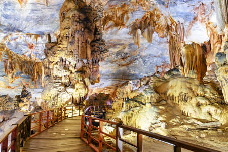 Scenic stalactites and stalagmites at amazing chamber inside Paradise Cave (Thien Duong Cave) at Phong Nha-Ke Bang National Park in Vietnam. Paradise Cave is a popular tourist attraction of Asia. 스톡 콘텐츠