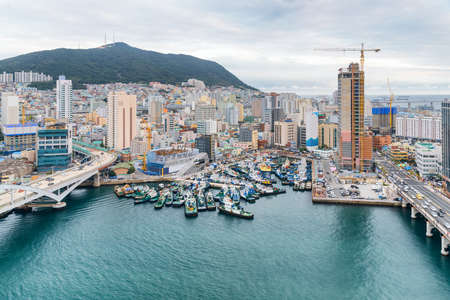 Top view of ships parked at Busan Harbor in South Korea. Scenic Yeongdo Island. Amazing cityscape. Stock Photo
