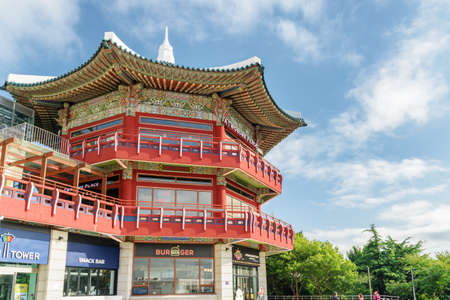 Busan, South Korea - October 7, 2017: Wonderful view of octagonal pavilion on blue sky background at Yongdusan Park. Amazing colorful building of traditional Korean architecture.