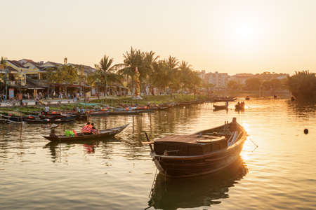 Hoi An (Hoian), Vietnam - April 11, 2018: Beautiful view of tourist boats on the Thu Bon River at sunset.