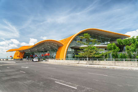 Dalat, Vietnam - October 13, 2018: Main view of Lien Khuong International Airport. Scenic yellow building of Da Lat Airport on blue sky background. Stock Photo - 117320468