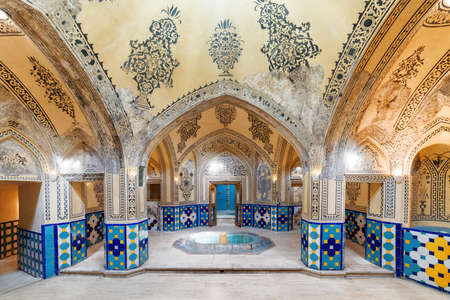 Kashan, Iran - 21 October, 2018: Hot bathing hall (garmkhaneh) at Sultan Amir Ahmad Bathhouse. Traditional Persian public bathhouse. Kashan is a popular tourist destination of the Middle East.