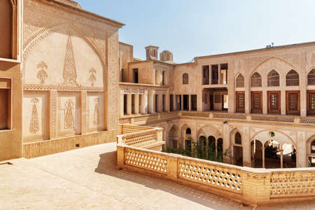 Scenic view of Abbasi Historical House from upper floor terrace in Kashan, Iran. Beautiful carved walls. Traditional Persian architecture. Kashan is a popular tourist destination of the Middle East. Editöryel