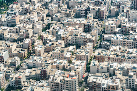 Aerial view of streets and residential buildings in Tehran, Iran. Tehran is a popular tourist destination of the Middle East.