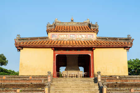 Beautiful view of Stele Pavilion (Bi Dinh) on blue sky background at the Minh Mang Tomb in Hue, Vietnam. Hue is a popular tourist destination of Asia.