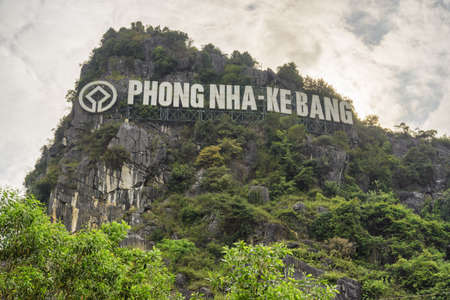 Sign of Phong Nha-Ke Bang National Park on scenic mountain at Phong Nha Village in Vietnam. Phong Nha-Ke Bang National Park is home to the largest cave in the world.