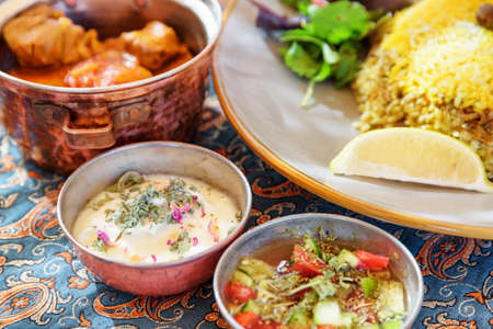 Iranian dishes and snacks. Polow, kufte, fresh vegetable salad and yogurt. Traditional Persian cuisine. Banco de Imagens