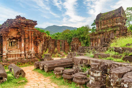 Amazing view of My Son Sanctuary among green woods in Da Nang (Danang), Vietnam. My Son is a complex of partially ruined ancient Hindu temples constructed by the kings of Champa.
