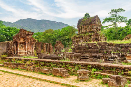 Unusual view of My Son Sanctuary among green woods in Da Nang (Danang), Vietnam. My Son is a complex of partially ruined ancient Hindu temples constructed by the kings of Champa.