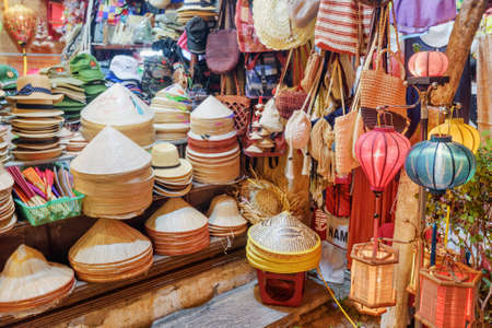 Hoi An (Hoian), Vietnam - April 11, 2018: Traditional gift shop in Hoi An Ancient Town. Wide range of bamboo hats, colorful lanterns and handmade wicker bags. Amazing Vietnamese souvenirs. Redakční